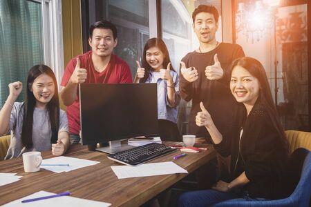 asian younger freelance teamwork  job successfull happiness emotion Zdjęcie Seryjne