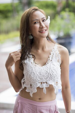 portrait of beautiful asian younger woman smiling face with happiness emotion