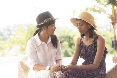 two asian younger woman talking with unhappy emotion