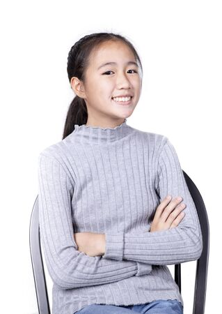 toothy smiling face asian teenager isolated white background Zdjęcie Seryjne