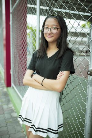 face of asian teenager wearing eye glasses relax and smiling face Zdjęcie Seryjne