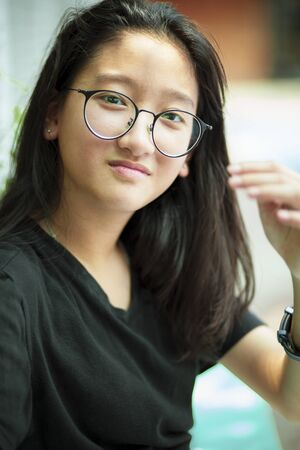 headshot of asian teenager toothy smiling face with happiness emotion