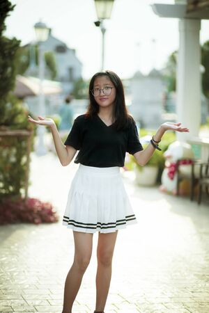 beautiful asian teenager with unhappy face standing outdoor Zdjęcie Seryjne