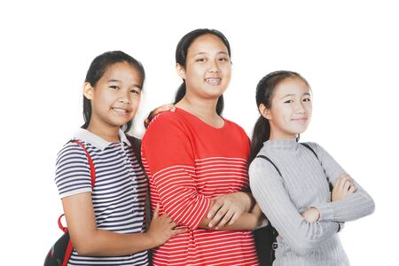 group of asian teenager smiling face standing against white background
