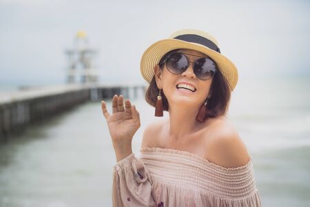 cheerful  asian woman  happiness emotion at sea beach