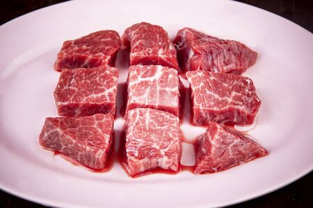 chunk of good quality uncooked beef prepare on dish