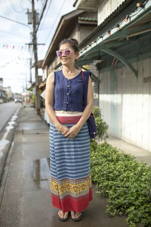 beautiful asian woman wearing thai tradition clothes standing outdoor