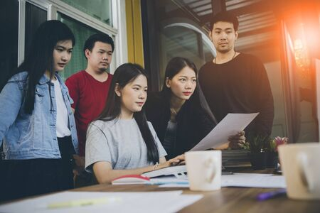 asian younger freelance team concentrate on working project in computer monitor