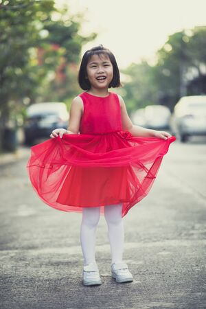 asina children girl wearing red skirt dress toothy smiling face happiness emotion