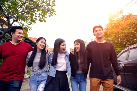 group of asian younger man and woman relaxing toothy smiling face with happiness emotion