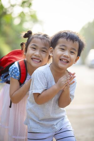 two lovely asian children boy and girl with kidding smiling face