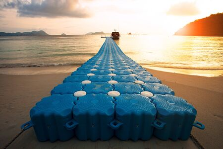 floating pier at andaman island against beautiful sun rising sky