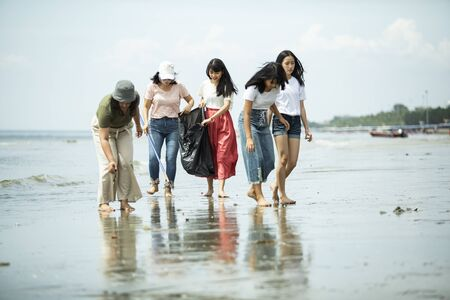 group of volunteer keep clean on sea beach