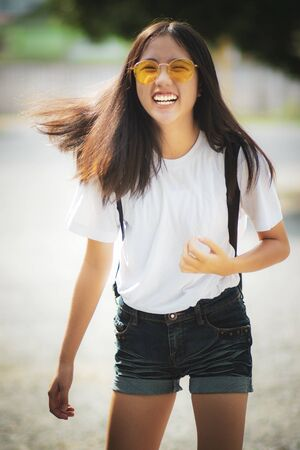 asian teenager laughing with happiness emotion standing outdoor Stock fotó