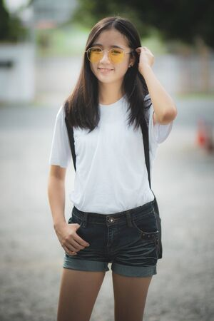 asian teenager toothy smiling face happiness standing outdoor Stock fotó