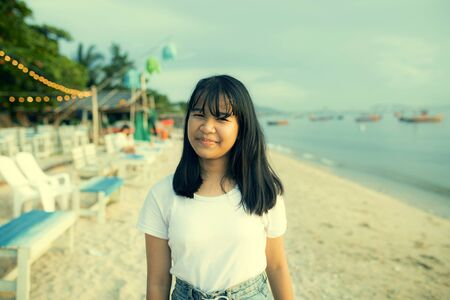 asian teenager smiling face happiness on summer vacation sea beach