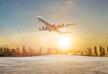 jet plane flying over runways and beautiful dusky sky with copy space use for air transport ,journey and traveling industry business  Stock fotó