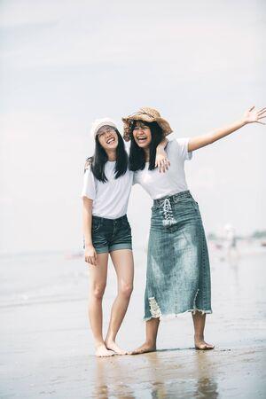 two cheerful asian teenager happiness on vacation sea beach Standard-Bild - 134653350