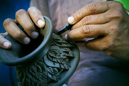 close up potter artist working on clay pottery sculpture fine art in thailand