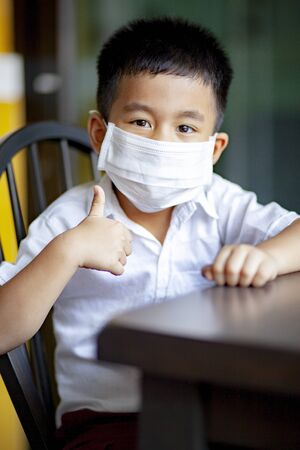 asian children wearing protection mask  quarantine at home