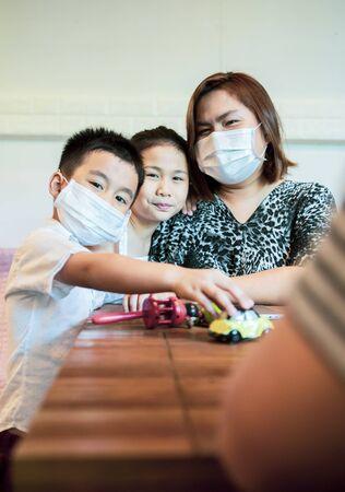 asian family quarantine at home while corona virus ,covid-19 infected