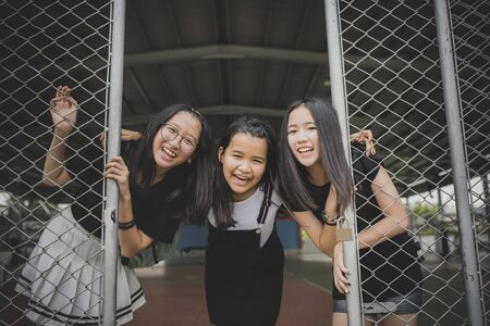 portrait kidding face group of asian teenager relaxing on traveling location
