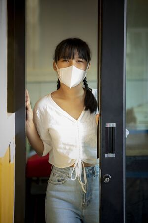 asian woman wearing protection mask while covid-19 ifected in bangkok thailand