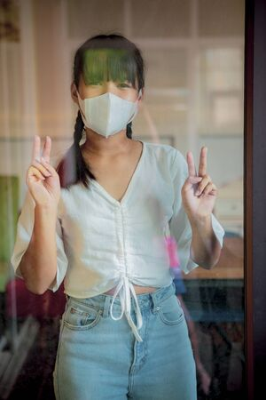 asian teenager wearing protection mask quarantine at home while covid-19 virus infection
