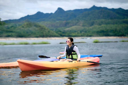 woman sailing kayak boat in water sport pool