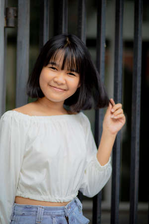 cheerful asian teenager happines smiling face standing outdoor