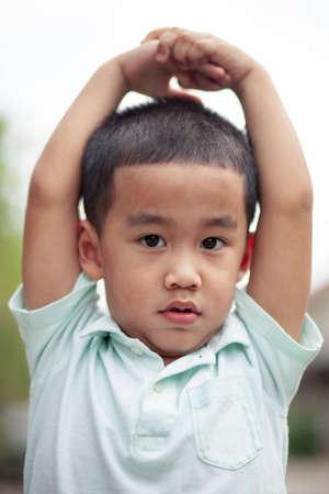 headshot of asian children looking to camera