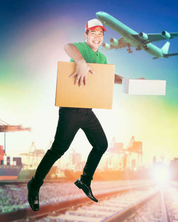delivery man delivering carton box against logistic business background