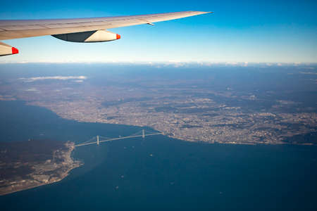 aerial view from plane window over Akashi-Kaikyo Bridge crossing osaka bay japan