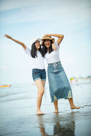 two asian teenager happiness on sea beach Stock fotó