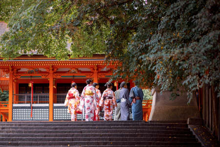 kyoto japan - november9,2018 : unidentified japanes people wearing old traditon gimino clothes walking in fushimi inari shrine one of most popular traveling destination in kyoto japan