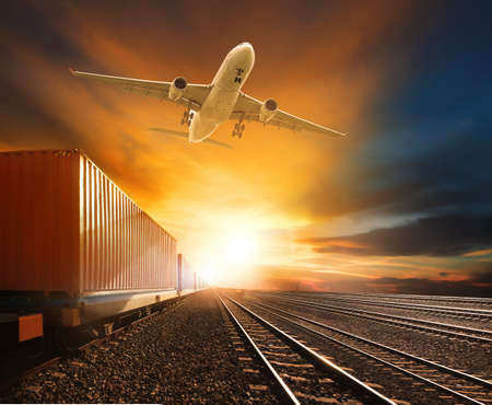 logistic trains and cargo plane flying against beautiful sky background Reklamní fotografie