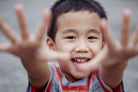headshot of cheerful asian children looking with eye contact to camera Stock fotó