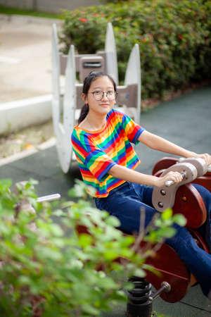 asian teenager relaxing in public park Stock fotó