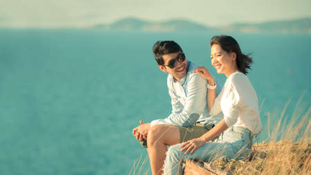 asian younger couples relaxing at sea side