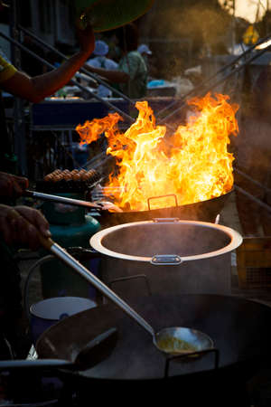 fire burning over street food cooking stove in bangkok thailand