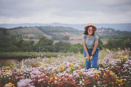 beautiful woman standing in blooming flower garden