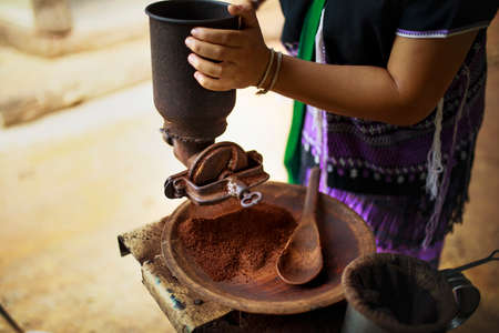 old tradition coffee seed grinding in thailand