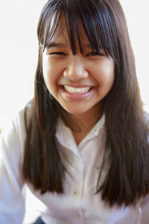 toothy smiling face of asian teenager
