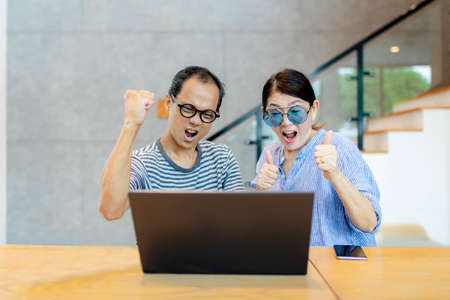 asian couples amazing face and looking to computer laptop screen