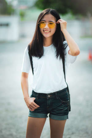 asian teenager toothy smiling face standing outdoor 版權商用圖片