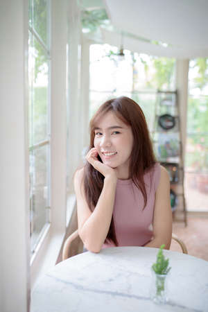 beautiful asian younger woman relaxing and toothy smiling