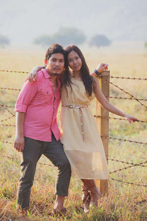 portrait of asian couples standing in ranch farm