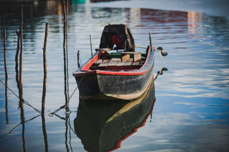 old wooden boat floating over plain water