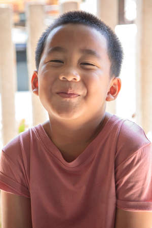 smiling face of asian children standing outdoor
