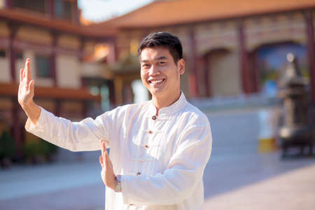 chinese man toothy smiling face pose for healthy exercise